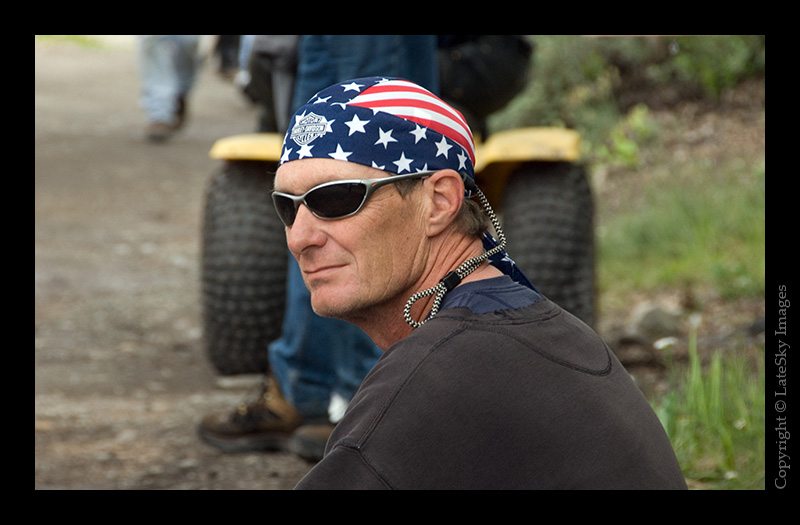 559 - Relaxed spectator adorning some patriotic headwear.