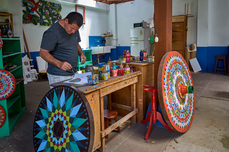 Painting the ox cart wheels of Sarchi