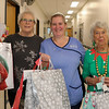 25 DEC 2019 – Pictured: Sheena Parson (Hon Secretary, H&D Fellowship for the Sick) with Penny Townsend (HCA) and Betty Holbrook MBE (Vice Chair, H&D Fellowship for the Sick) - Harwich & District Fellowship for the Sick Christmas Gifts – Trinity Ward, Harwich Fryatt Hospital, Dovercourt. – Photo Copyright © Maria Fowler 2019