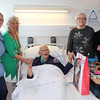25 DEC 2019 – Pictured: Penny Townsend (HCA), Betty Holbrook MBE (Vice Chair, H&D Fellowship for the Sick) with patient Revd Roger Packer, Sheena Parson (Hon Secretary, H&D Fellowship for the Sick) and Revd Canon Margaret Shaw. - Harwich & District Fellowship for the Sick Christmas Gifts – Trinity Ward, Harwich Fryatt Hospital, Dovercourt. – Photo Copyright © Maria Fowler 2019