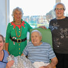 25 DEC 2019 – Pictured:  Penny Townsend (HCA) with Betty Holbrook MBE (Vice Chair, H&D Fellowship for the Sick) patient Rex Braddy and Sheena Parson (Hon Secretary, H&D Fellowship for the Sick) - Harwich & District Fellowship for the Sick Christmas Gifts – Trinity Ward, Harwich Fryatt Hospital, Dovercourt. – Photo Copyright © Maria Fowler 2019