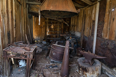 The Bodie blacksmith shop, complete with anvil, giant bellows, and other historic items.