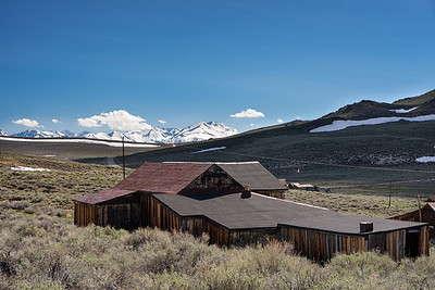One of Bodie's old barns with snow on the mighty Sierra Nevadas in the background.