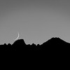 Crescent moon setting over the mountains near Bishop, California