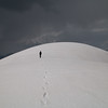 Chris approaching the actual highest point (13,385 ft).  The weather was turning bad in the distance...