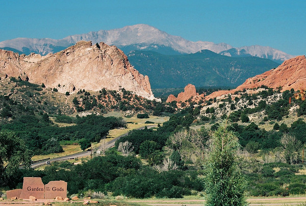"""<p class=""""imgcaptl"""">Garden of the Gods</p> <p class=""""imgcapts"""">Colorado Springs, CO.</p> <p class=""""imgcaptx"""">The massive vertical sandstone formations are imposing, even at this distance.</p> <p class=""""imgcaptxa""""><span class=""""osnbrz"""">Pike&#39;s Peak</span> is in the background.</p> <p class=""""imgcapfn"""">4285510-R1-019-8 from Nikon 65 35mm film</p>"""