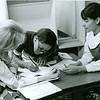 Volunteer tutoring teens, 1970s