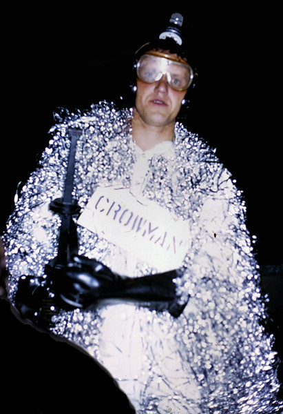 "Crowman - Advanced Technology Secret Weapon  Emerging from a cloud of Chaff, armed with a high-power RF waveguide, radiating what appears to be high intensity infrared from his head,  It's CROWMAN!  Baffling opposing radar and missles, confusing and distracting system operators, CROWMAN was the original ""Shock and Awe"" weapon of mass confusion.  ( More about crows and ravens and ECM here: <a href=""http://www.ourspecialnet.com/gallery/6147853_pQBni#388036706_ShJdP"">ECM Ravens</a> )  I believe this airman's name was 'Couches'   Takhli Thailand, 1968-1969"