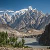 A narrow suspension bridge spans the Hunza river near the Passu Cathedrals in Gojal, Gilgit Baltistan