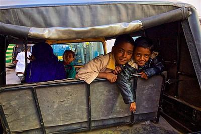 Smilling tuktuk passengers