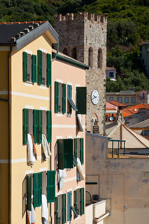 Drying laundry out the windows next to the 13th-century tower of San Giovanni Battista.  The watch tower was built to be a part of the five towns' defensive network, and was later incorporated as the bell tower for the church.