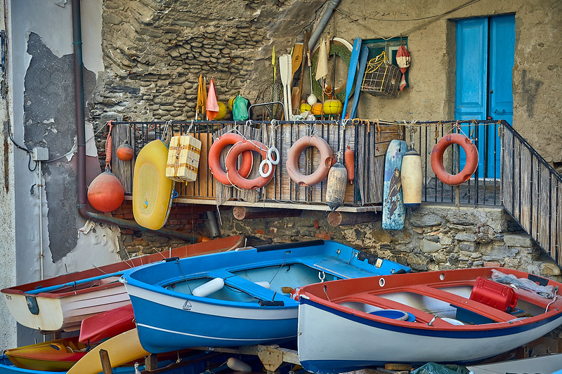 Small boats sit dry above the ramp of Riomaggiore's tiny port.  Italy.