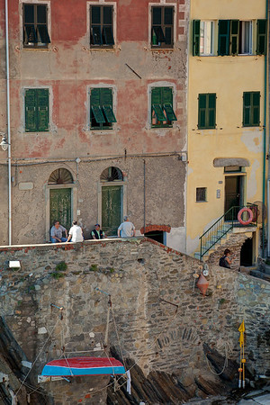 Locals sit and enjoy each other's company in the laid-back world of Cinque Terre.