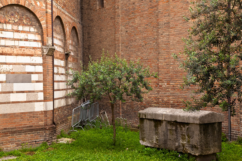 Bike racks sit behind an ancient tomb on the lawn in front of the 11th-century Church of San Sepulcro, in the Sette Chiese complex of Santo Stefano.