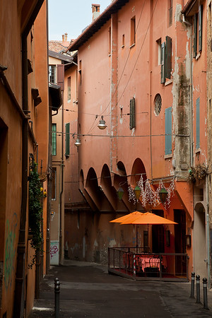 Bologna is known for its porticoes.  The streets all have different styles of porticoes, depending on what year they were constructed.
