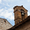 The brick belltower of the 13th-century Chiesa San Rocco, a tiny chapel in Arsoli, Italy.