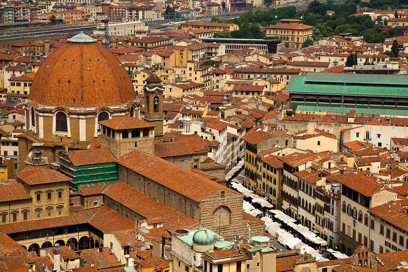 Looking down on the Florence street market from the the top of the Basilica di Santa Maria del Fiore, with the Medicee Chapel looming over the market.