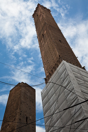 The Two Towers of Bologna, constructed in the 12th century.  The taller Torri degli Asinelli is 321 feet, leans slightly, and can be climbed via almost 500 steps.  Torri Garisenda is half that height, and is closed to entry because it leans even more.