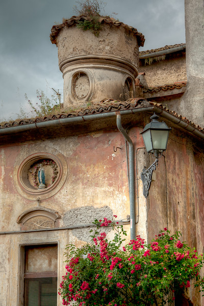 This old house sits next to the 11th-century Benedictine Castle Massimo.  Arsoli, Italy.