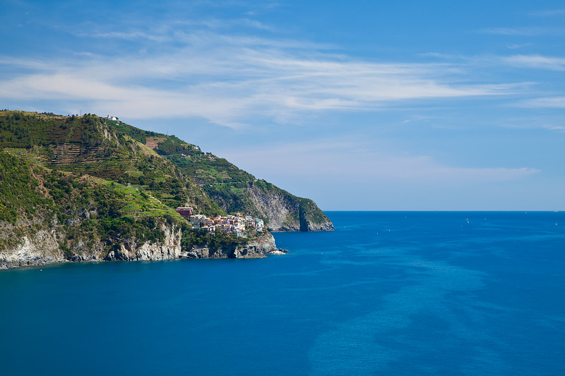 The small cliffside town of Manarola as viewed from Corniglia.