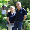 """13 JUN 2021 - PICTURED: Aileen Farnell (Membership Secretary, Harwich Society) and Colin Farnell (Chairman, Harwich Society) at Bobbit's Hole Nature Reserve with sundial, in remembrance of those affected by the Coronavirus Pandemic 2020/21. Photo Copyright © Maria Fowler 2021<br /> <br /> PRESS RELEASE<br /> Harwich Society installs COVID-19 memorial in Bobbit's Hole<br /> <br /> The Harwich Society has installed a memorial to the memory of everyone who passed during the COVID-19 pandemic and whose loved ones were not able to commemorate their passing in the manner in which they would have wished.<br /> <br /> The board of Trustees believed that there was a need for such a memorial and, as a result, a sun dial has been erected in the Society's Bobbit's Hole Nature Reserve bearing the inscription, 'However dark the clouds are the Sun is always shining above them '.<br /> <br /> Chairman of the Harwich Society, Colin Farnell, says, """"COVID-19 has had an impact on everyone who has lost someone close to them whether it was as a result of the disease or not. No one has been able to commemorate the end of a life in the manner that they would have wished and this memorial is for everyone who has found themselves in this position.""""<br /> <br /> The inscription was suggested by one of the Harwich Society's trustees who heard the late Dr. Perry use the words in an address given in Saint Nicholas Church in 2000.<br /> <br /> """"We wanted a memorial that would reflect the need and would be appropriate for everyone,"""" continued Colin Farnell. """"A sun dial is timeless and the inscription offers hope at a difficult time. We hope it will provide a point of comfort.""""<br /> <br /> A bench is to be installed adjacent to the memorial.<br /> <br /> An official unveiling is to be arranged once COVID-19 restrictions are no longer in place.<br /> <br /> For further information please contact<br /> <br /> Colin Farnell on 01255 553610<br /> Garry Calver on 01255 551940"""