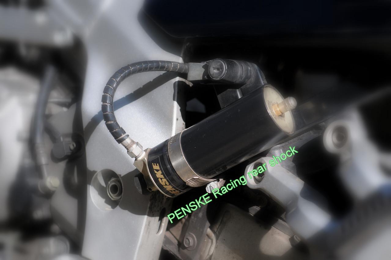 Penske Racing remote reservoir for rear suspension.