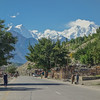 The massive hulk of Nanga Parbat broods over a village along the KKH
