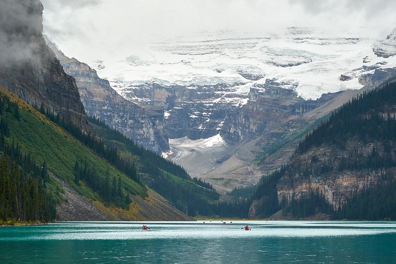 Paddling canoes on Lake Louise, Banff National Park