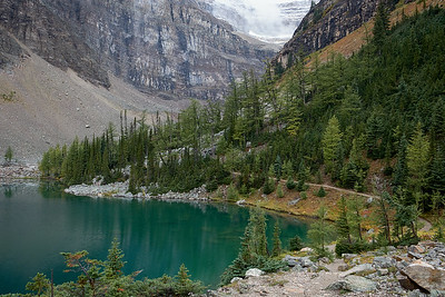 Hiking along the shores of Lake Agnes, Banff National Park