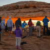 The line of photographers at Mesa Arch at sunrise