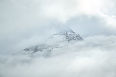 Mountaintop peeking through the clouds, Jasper National Park