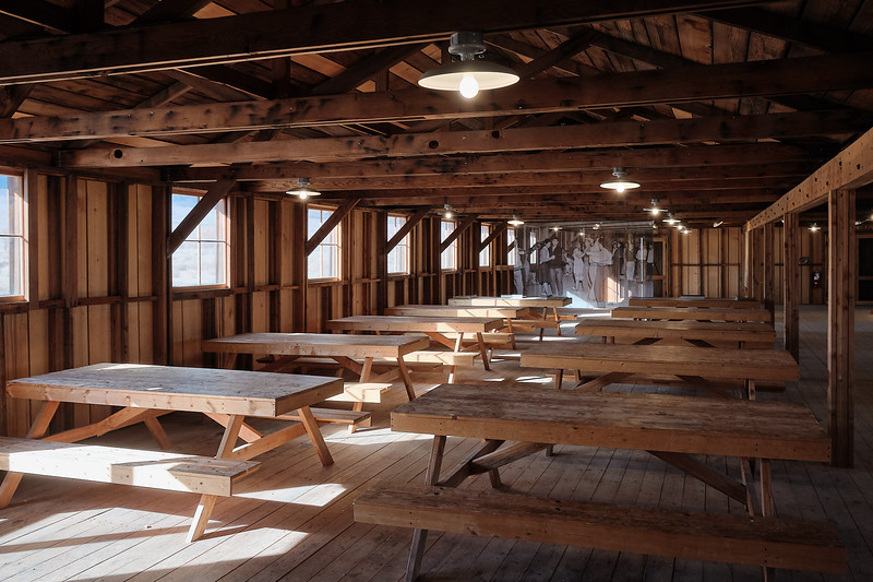 Benches inside the mess hall at Manzanar National Historic Site