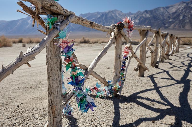 Paper cranes left at the Manzanar cemetery