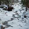 The trail to the Bridalveil Falls viewpoint, with the creek covered in snow and ice.