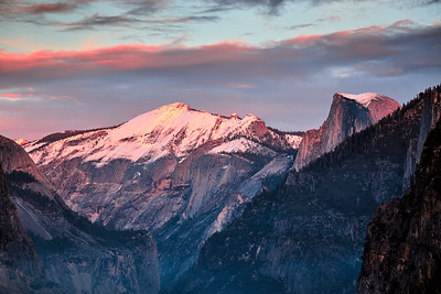 Sunset colors on a snow-covered Cloud's Rest and Half Dome from Artist Point.