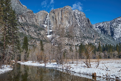 The Merced River and Yosemite Falls on a clear winter day.