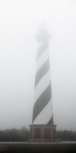 """The """"tallest brick lighthouse in the U.S."""" - Hatteras - is barely completely visible in the morning fog"""