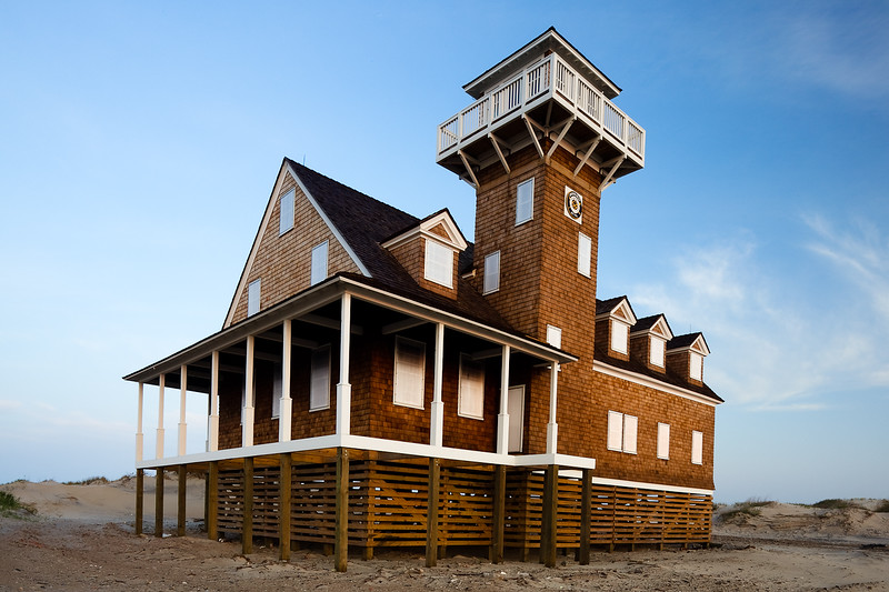 This historic building was just completely restored in the last year.  It was built in 1897 and abandoned in 1988 for a new station.  It had since been vandalized and covered in dunes.  This is how it looks now, restored and raised 10 feet off the sand.  Cape Hatteras National Seashore, North Carolina.