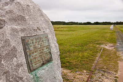 The spot where the first powered flight took off.  The four markers downtrack show where the first four flights landed.  Kill Devil Hills, North Carolina.