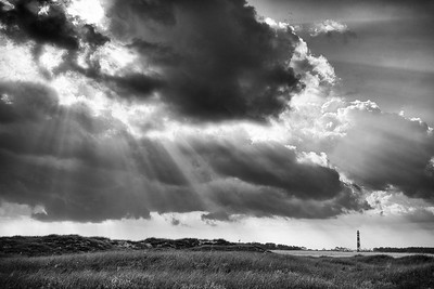 Cape Lookout Lighthouse under the rays of the sun, taken from Shackleford Banks, North Carolina.