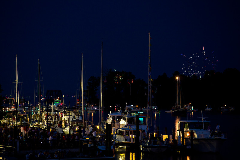 Waiting for the Washington July 4th celebration as fireworks continue east of town over the river