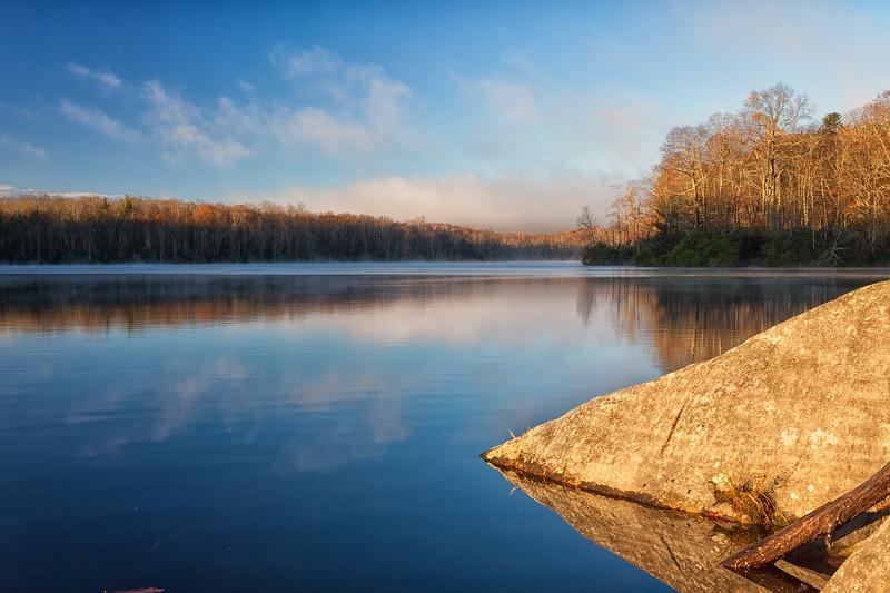 Early morning reflections on Price Lake, Pisgah National Forest, North Carolinan.