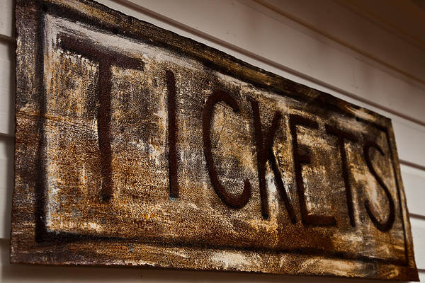 An old sign on the restored ticket booth