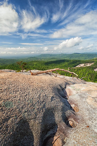 Looking towards Cedar Rock.  Water and wind have created some interesting shapes in the hard granite.  Stone Mountain State Park, North Carolina.