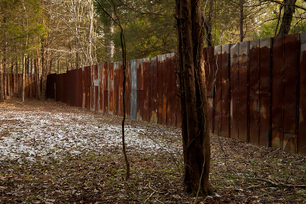 These rusted walls run a short span of the perimeter entering into Occoneechee Speedway