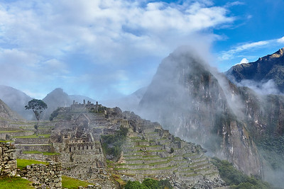 Morning fog and clouds covering Machu Picchu and Huaynapicchu.