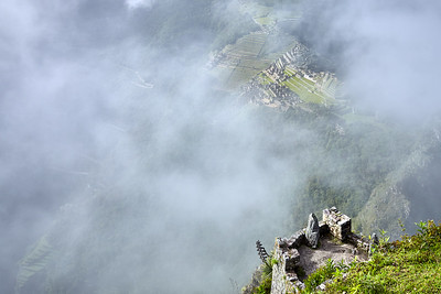 Looking at Machu Picchu through the clouds, from atop Huaynapicchu.