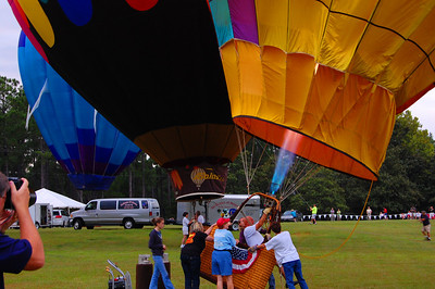 Everyone fires up their balloons for an early morning flight.  Of course there are more photographers than balloons!