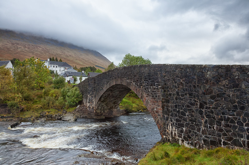 Another rainy start on my fifth day of the West Highland Way, looking over the old Bridge of Orchy to Beinn Dorain.  Scotland.