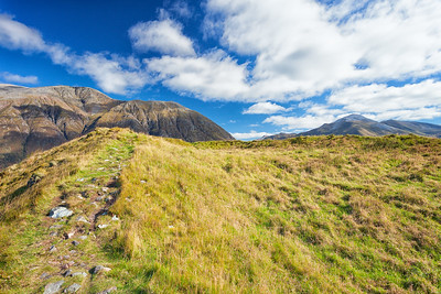 The top of this 1,165-foot mountain was used as a Celtic fort in the Iron Age, around 700BC.  It would have been surrounded by stone walls topped with wooden palisades, with roundhouses in the center.  Scotland.